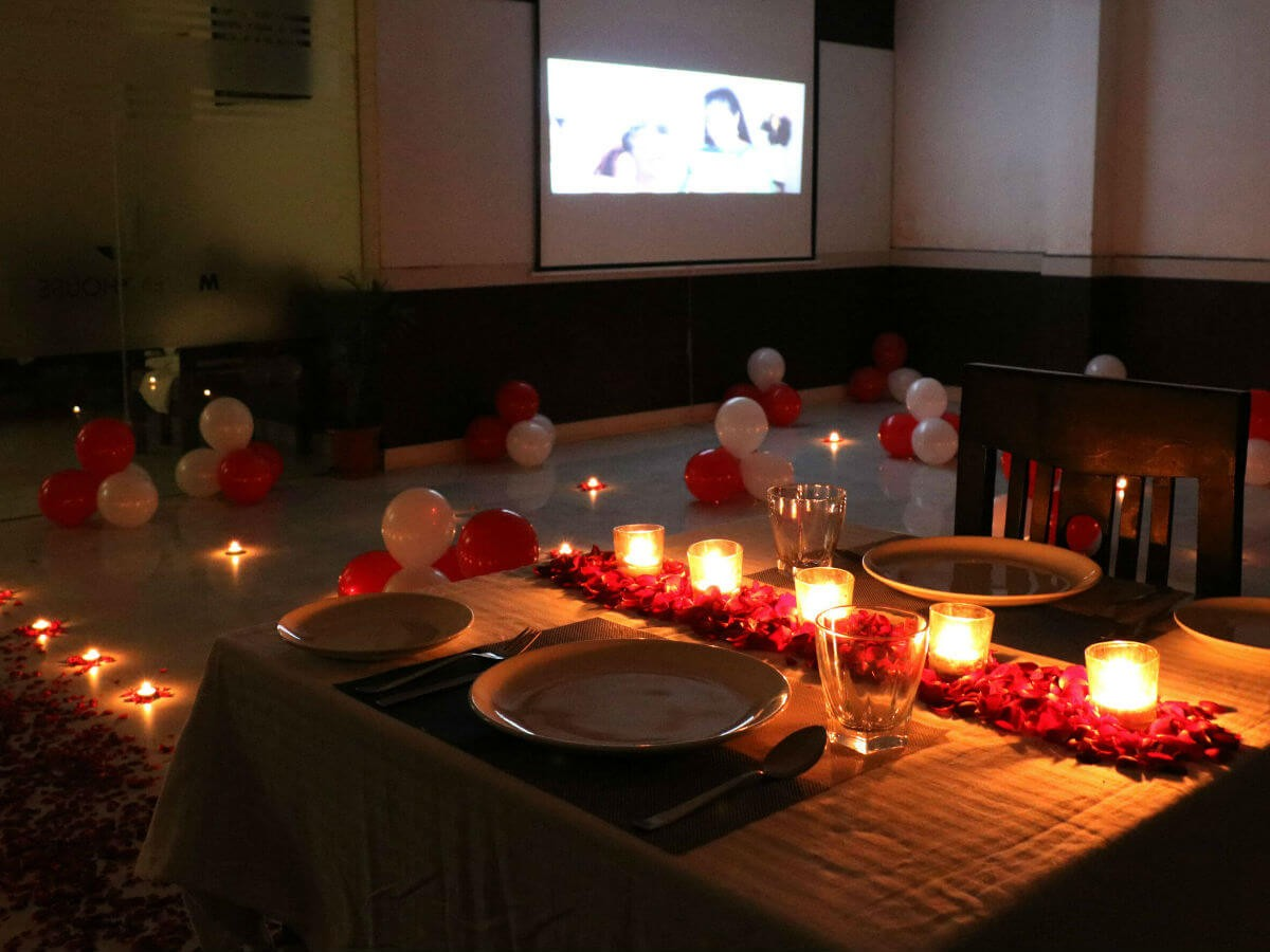Private dinner & movie - Movie setup with candlelight ...