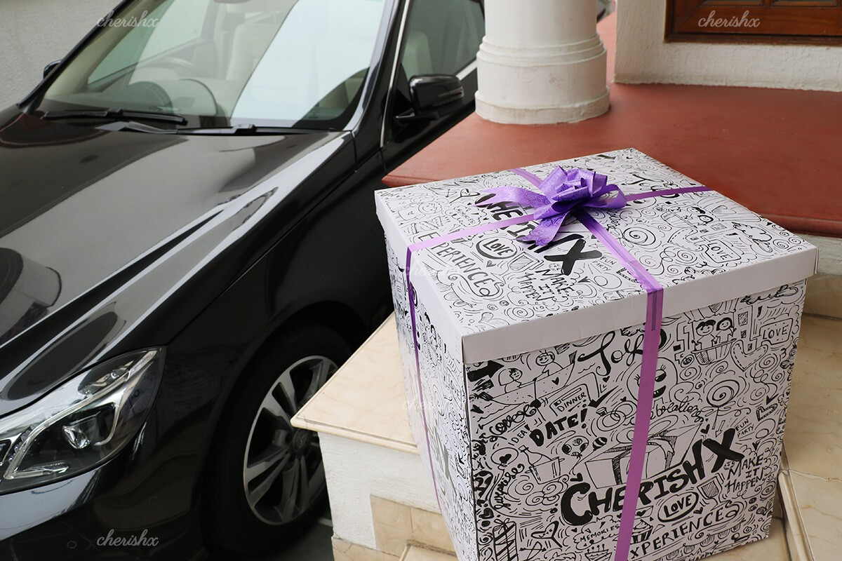 A surprise box packed with a purple ribbon.