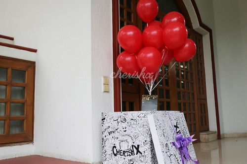 Bunch of Red balloons coming out of the surprise box.