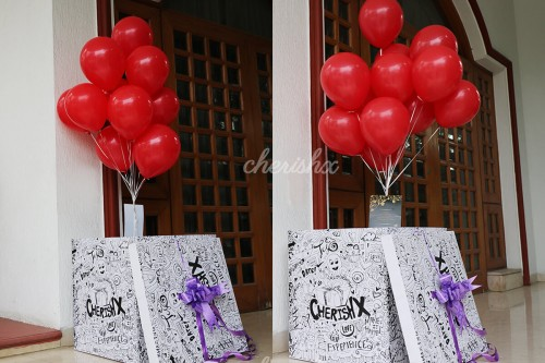 Balloon Box with Helium Balloons Flying out