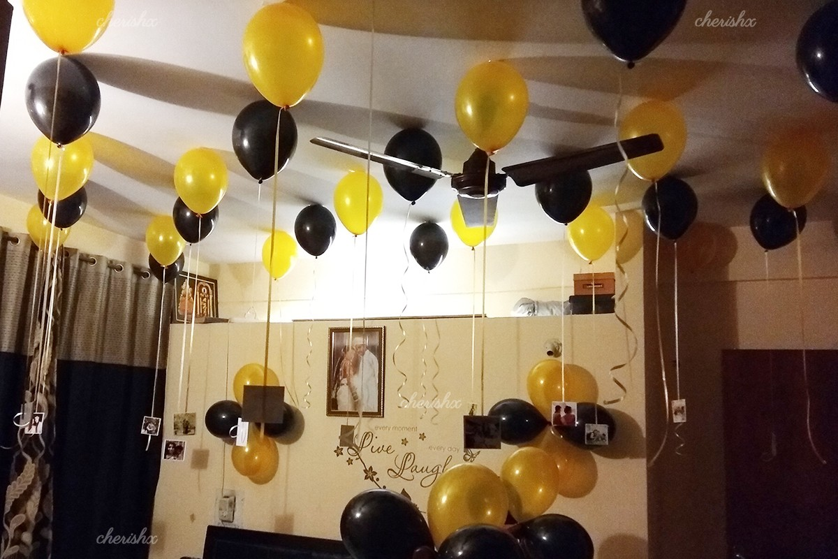 Balloon decoration in room with 200 balloons for celebrating any event at home
