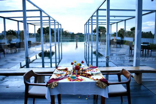 Poolside Dining by Miraya