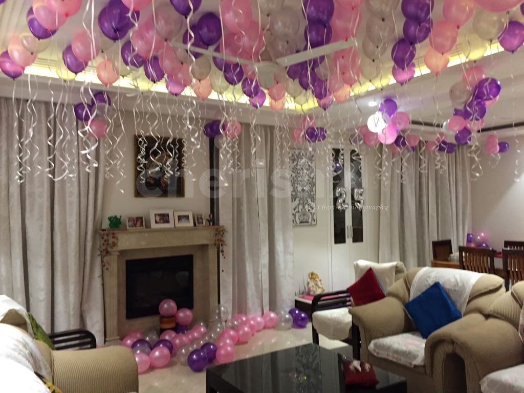 Beautiful Balloon Decor with hanging photos at your home