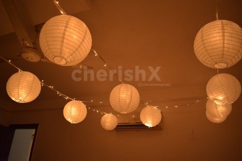 Decoration in Room with Lanterns and Fairy Lights.