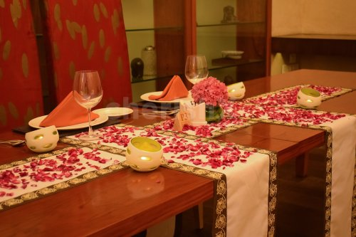 Candlelight Dinner with Flower Petals Table Decoration