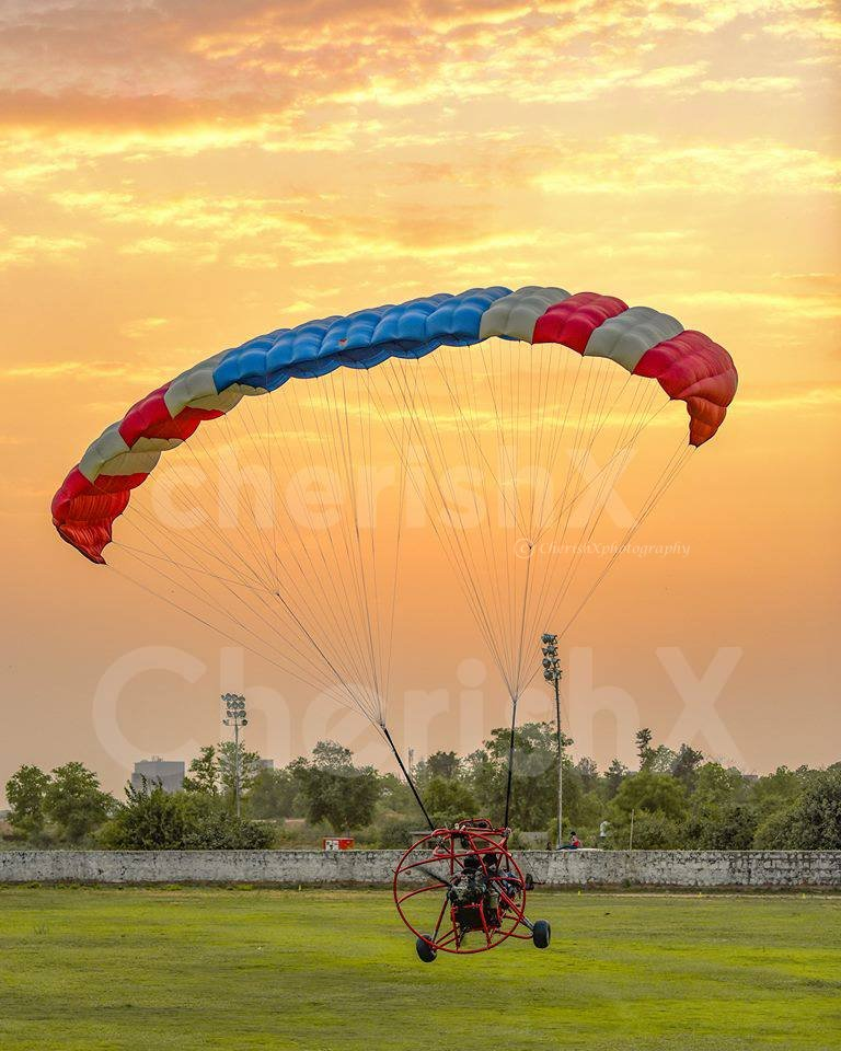 Enjoy the sunset with this Paramotoring Acitivity