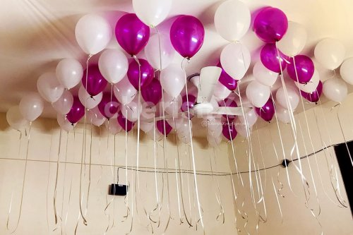 Pink and White Balloons glued to the ceiling for Balloon room decoration in Bangalore.