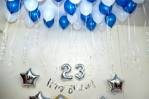 A birthday balloon room decor in a blue colour theme.