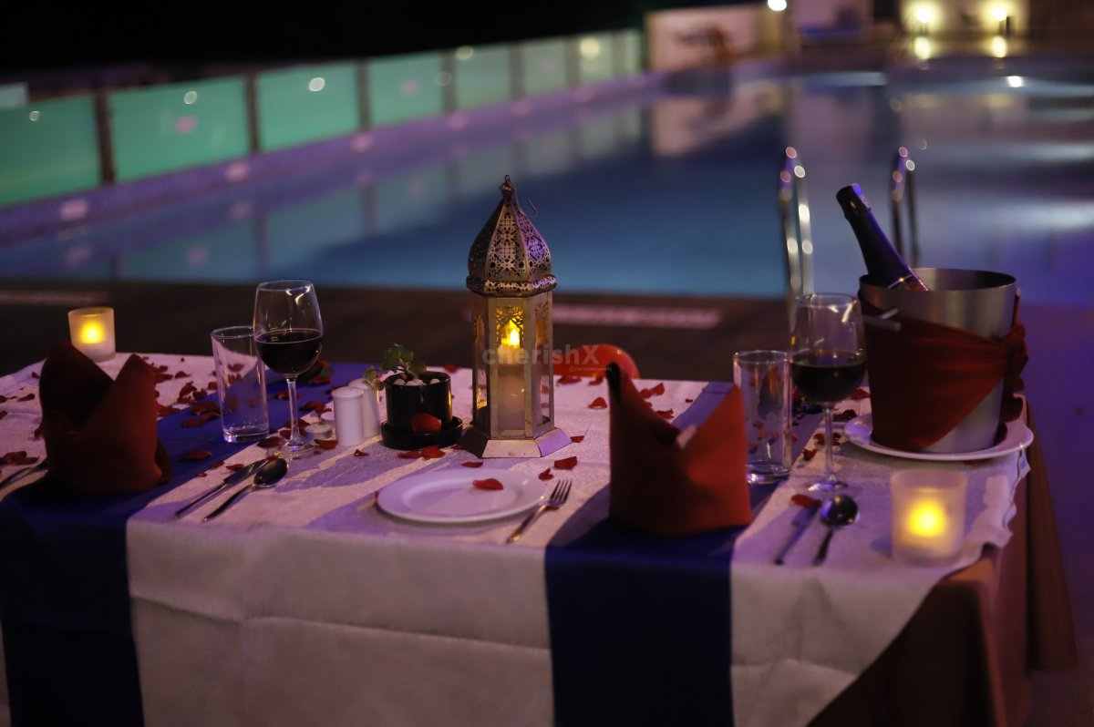 A special poolside setting awaits you with beautiful Candle Light and  flower petals decor.