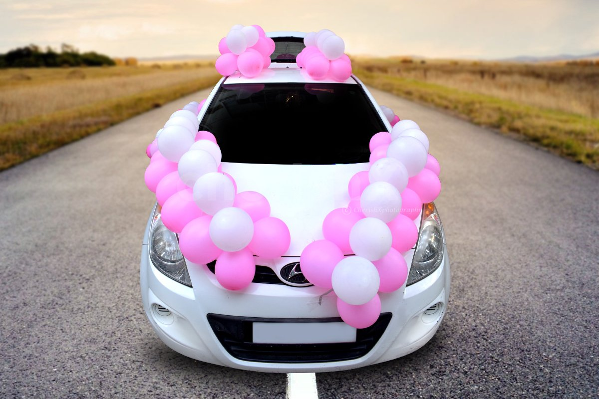 Make it special for the mother-to-be with this pink and white coloured car boot decor.
