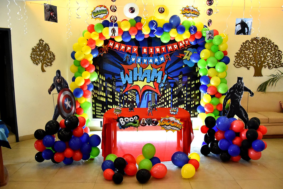 Book this fulfiling decor with balloons and superhero-themed cut-outs.