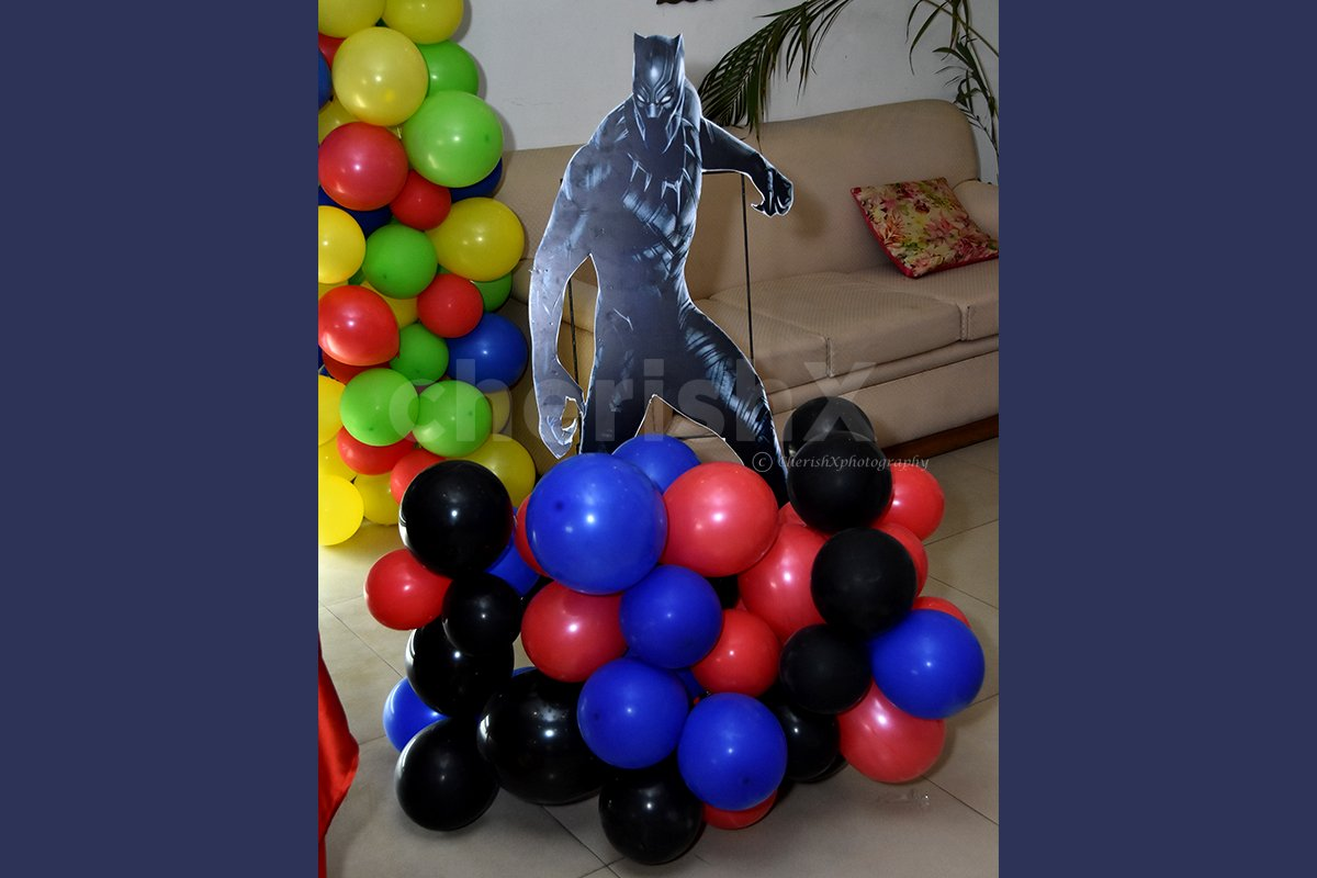 A Black Panther Cut-out stand on a colourful balloon bunch.