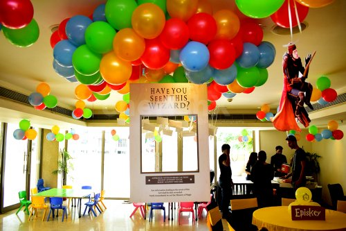 Coloured Bunches of balloons and Harry Potter Themed Photo Frame to create the Harry Potter Feels.