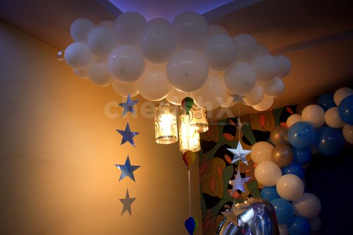 Inspired by Disney's Up, the white bunches of balloons depict the cloud in the overall room decoration.