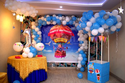 """The room decoration includes a wall decorated with an arch of balloons and a parachute made out of balloons to give the look of Disney's """"Up"""" Movie."""