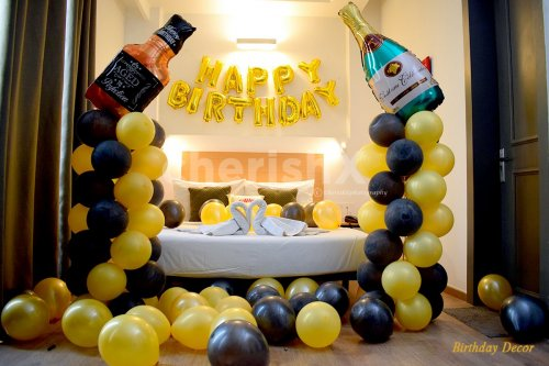 Birthday Champagne Themed Room decoration filled with yellow and black balloons.