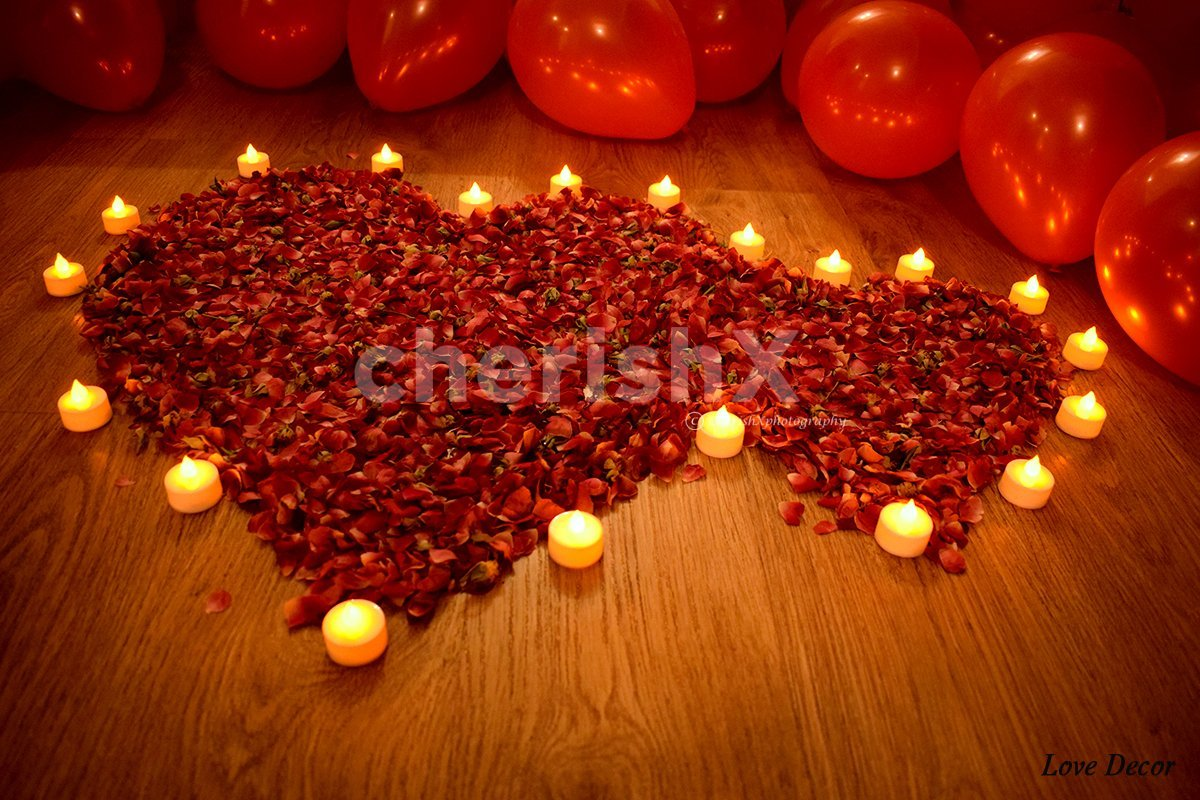Rose petals decoration on the floor to enhance the overall room decoration.