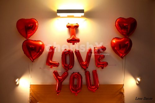 """Foil letters """"I Love You"""" Balloon decoration on the wall to enhance the overall love decor."""