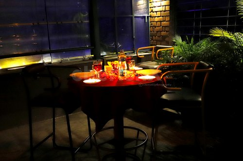Surprise your partner with this beautiful rooftop candle light dinner.
