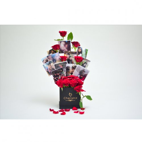 A CherishX's bucket with fresh roses and set up with pictures to gift to your friends or family.