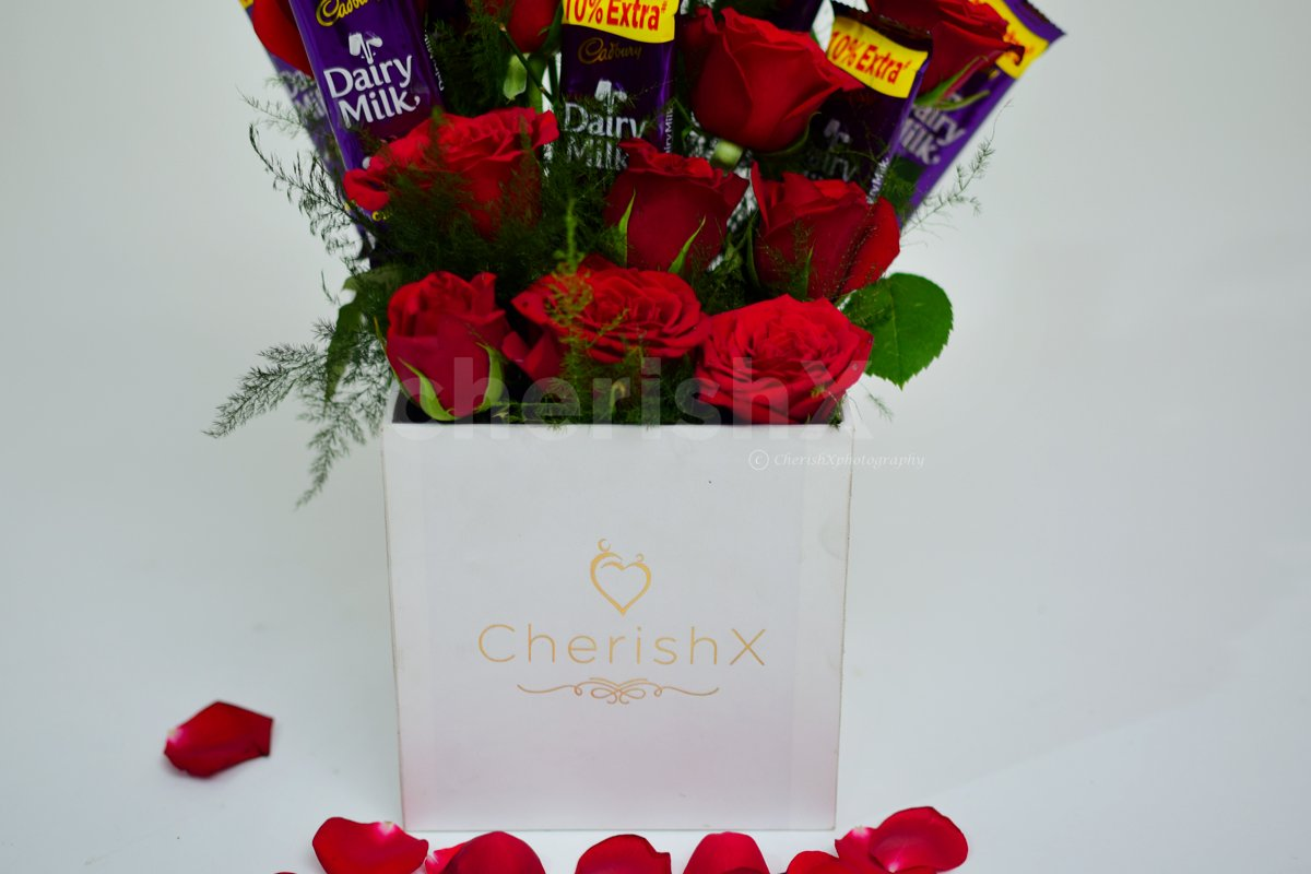CherishX offers you a charming Rose bucket with chocolates to make his/her day.