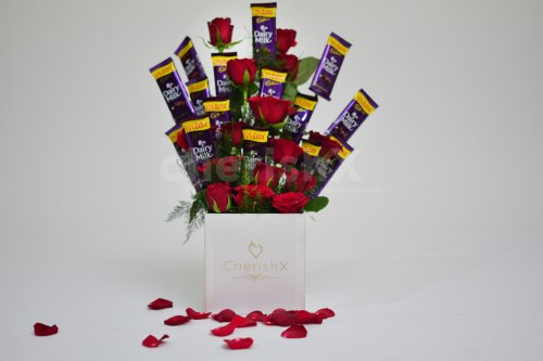 There are 15 roses and chocolates in this adorable bucket.