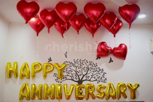 Happy Anniversary Foil Balloons and Heart-shaped foil Balloons used for making the decor romantic.