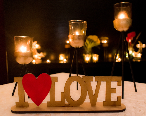 Love wooden Stand on table