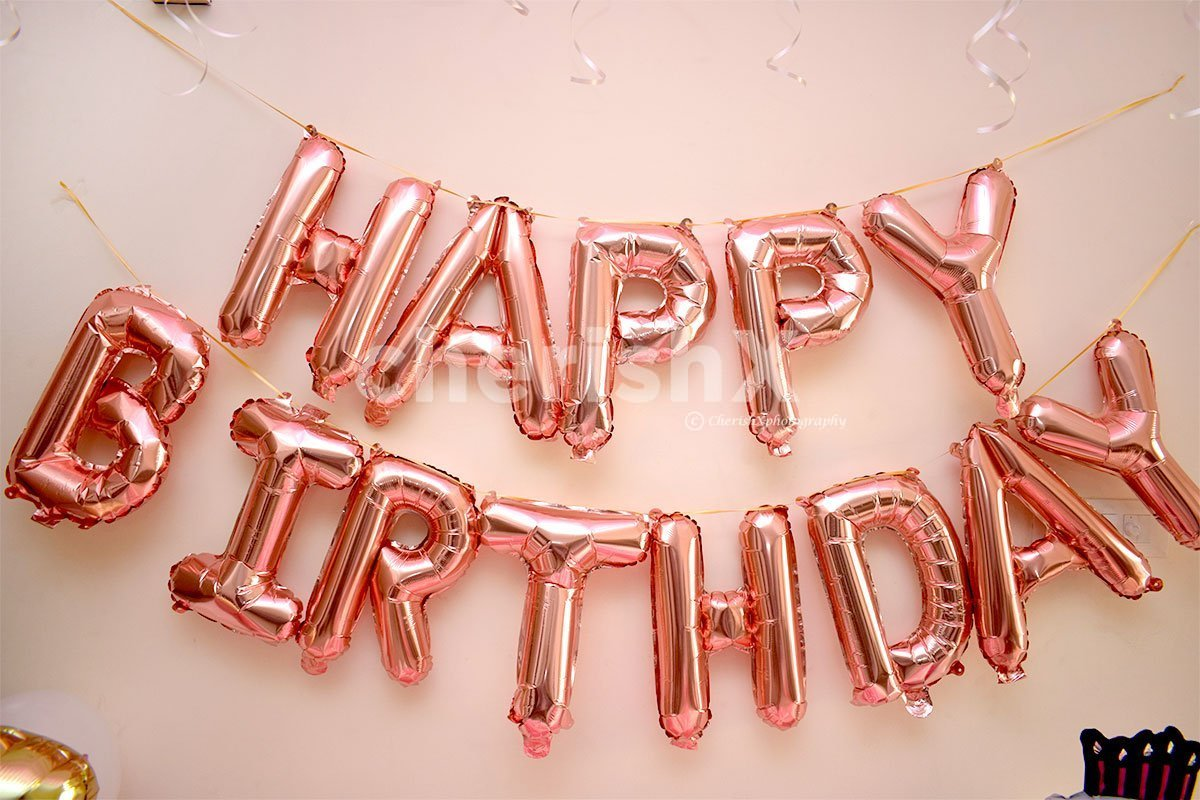 "Wall decoration with Pink ""Happy Birthday"" Foil Balloons."