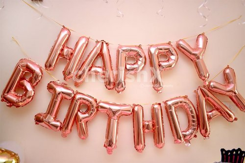 """Wall decoration with Pink """"Happy Birthday"""" Foil Balloons."""