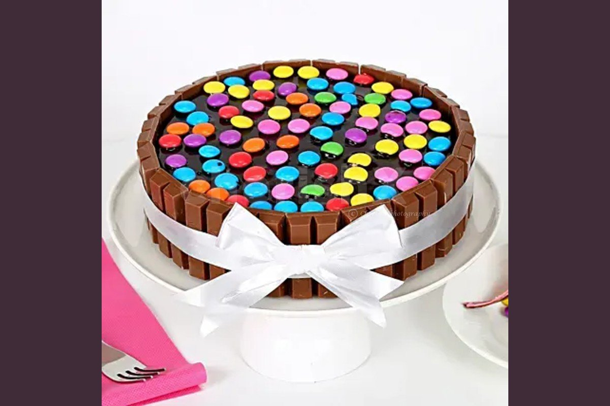 High rated and delicious kitkat gems cake delivered to your home