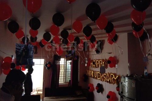 Red and Black Balloon Theme used for Anniversary Special Balloon Room Decoration.