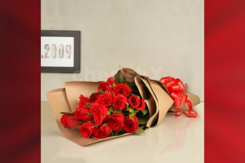 15 red roses bouquet in a special packing delivery at home