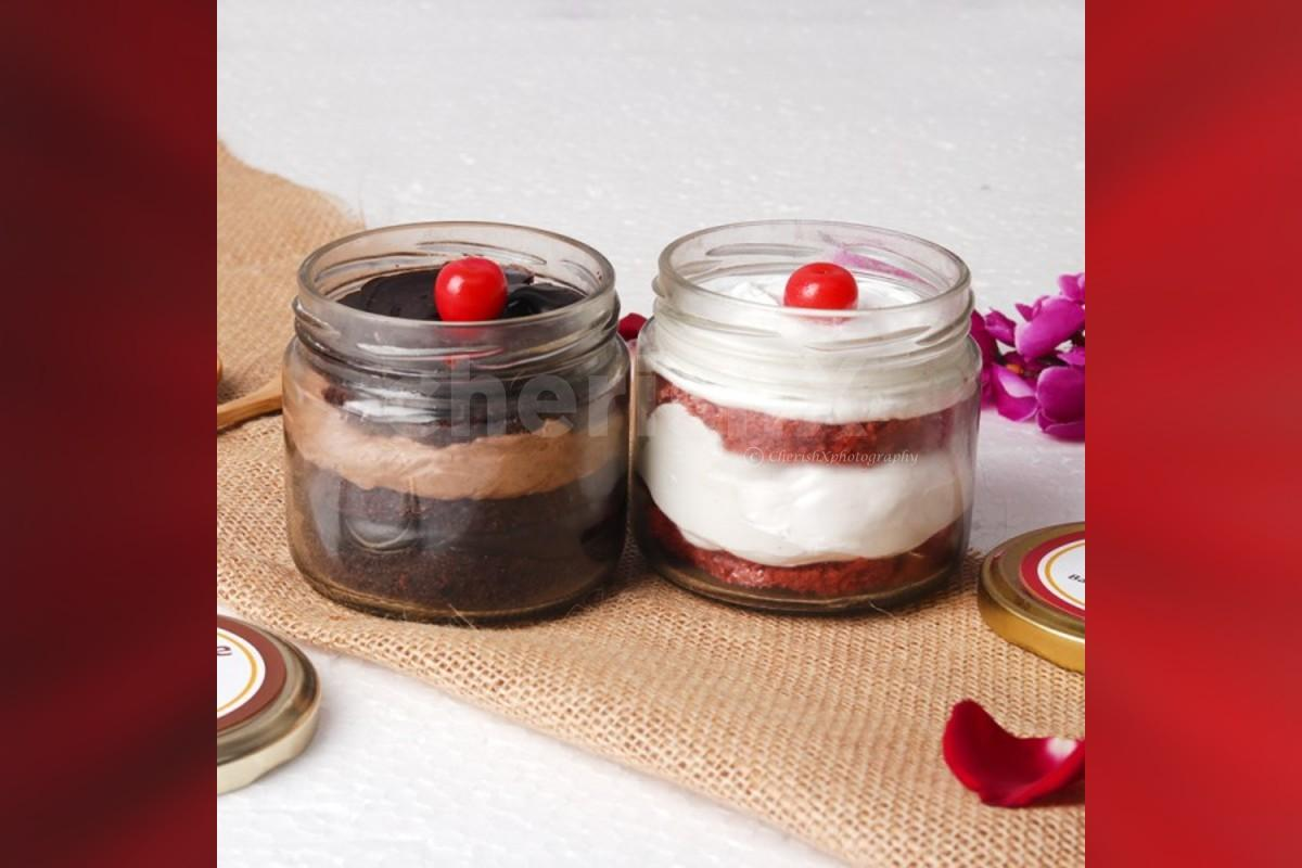 12 Red rose bouquet with 2 cake jars - red velvet and chocolate truffle flavors home delivery