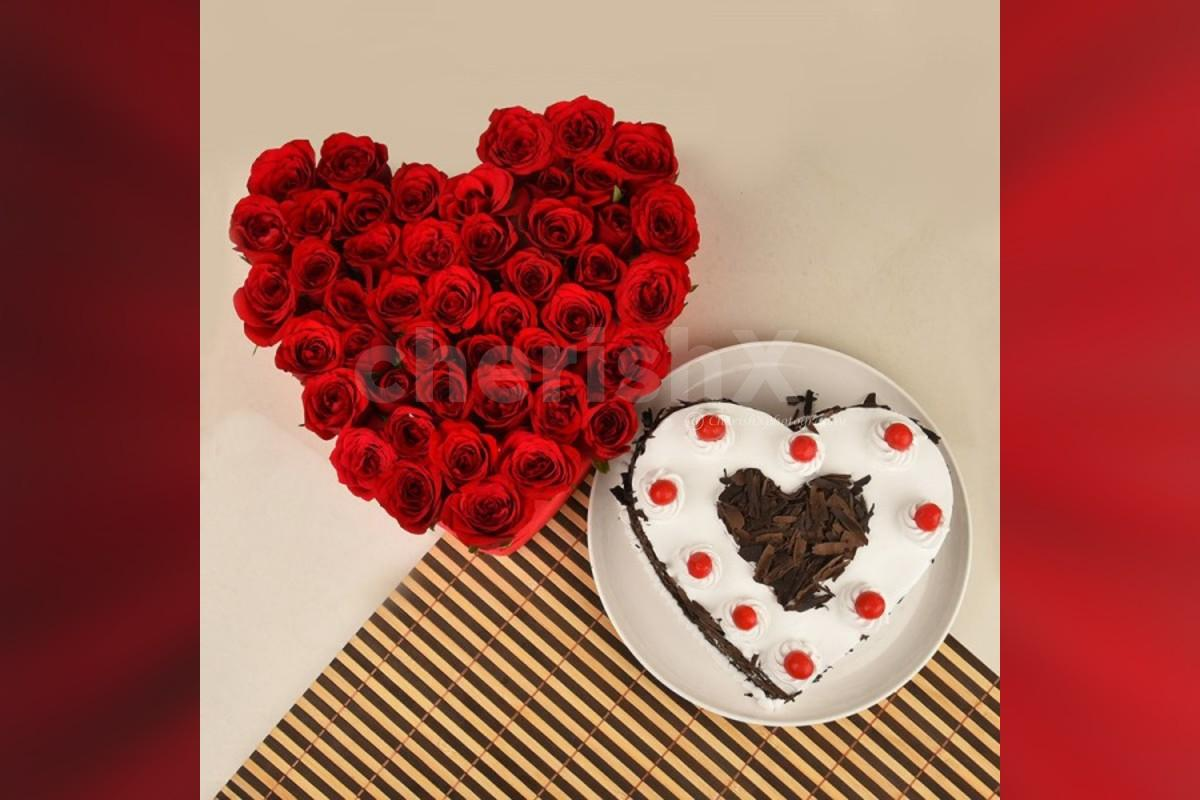 50 Red roses heart arrangement and a heart shape black forest cake