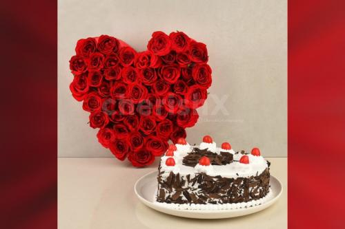 50 Red roses heart arrangement and a heart shape black forest cake home delivery