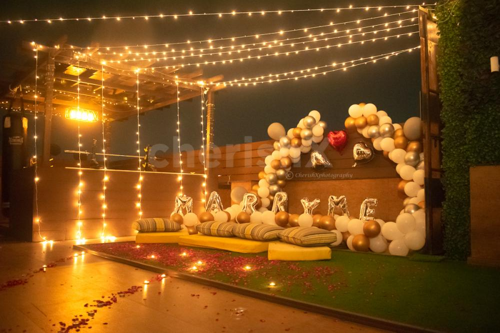 Fairy Lights on the Rooftop with Balloons and Arcs