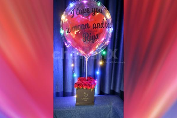 Express your love with this rose bucket with a love bubble for your loved ones