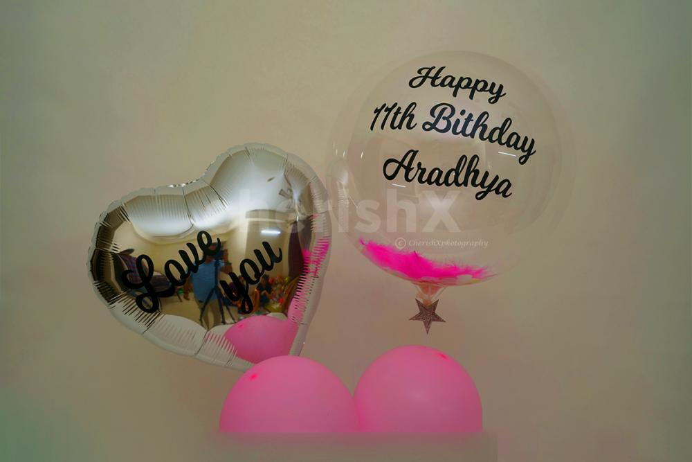 Tell someone you love them with this beautiful bubble balloon, filled with feathers through cherishx
