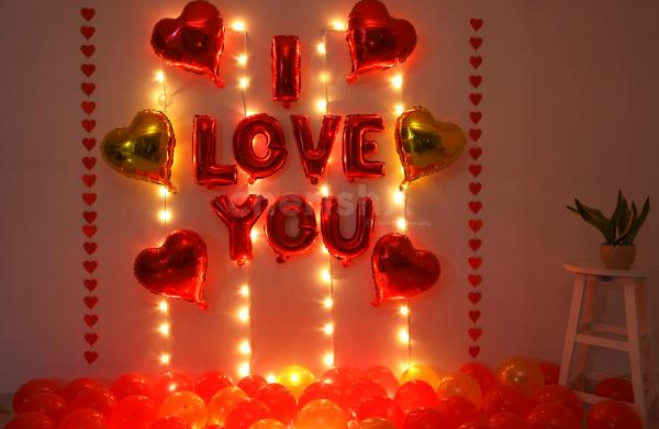 Romantic Balloon Decoration with I LOVE YOU foil balloons, heart shaped foil balloons and fairy lights