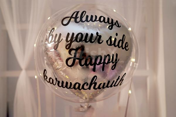 A Bubble Balloon with Silver foil balloon inside with vinyl printing.