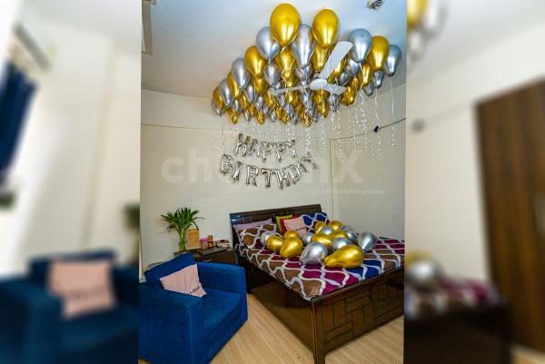 Golden and silver chrome balloon decoration by Cherishx at INR 2199