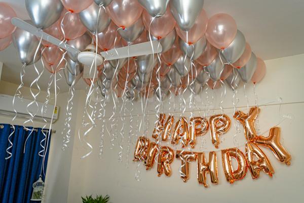 Rosegold and silver chrome balloon decoration by cherishx in delhi ncr