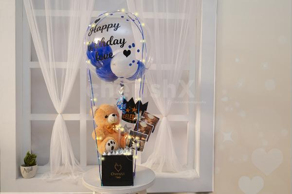 A cute teddy and chocolate box bucket to gift to your close ones.