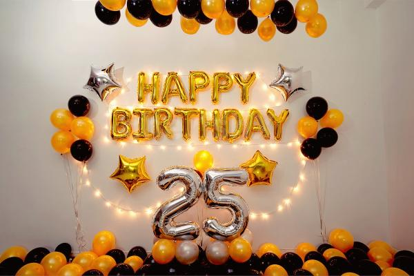 Happy Birthday wall decoration with a Golden and black theme.