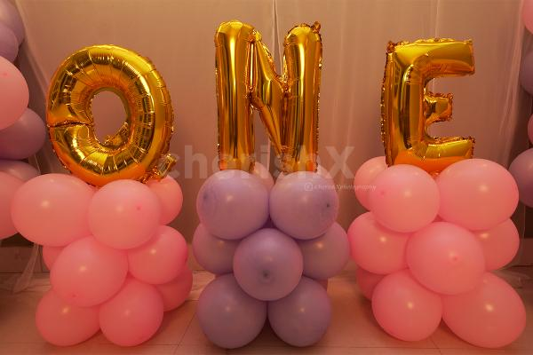 ONE Foil Balloon Letters in Golden to make the decor attractive!