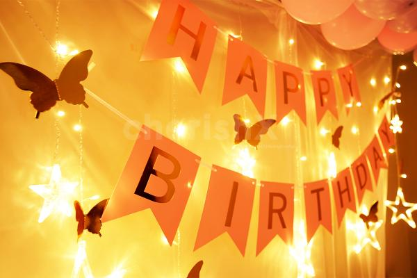 Room Decoration for Birthday Surprise with bright lighting.