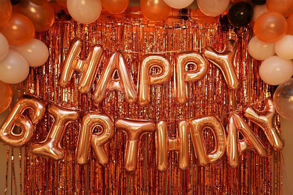 Rose Gold Happy Birthday Foil Balloons to enhance the room decor.