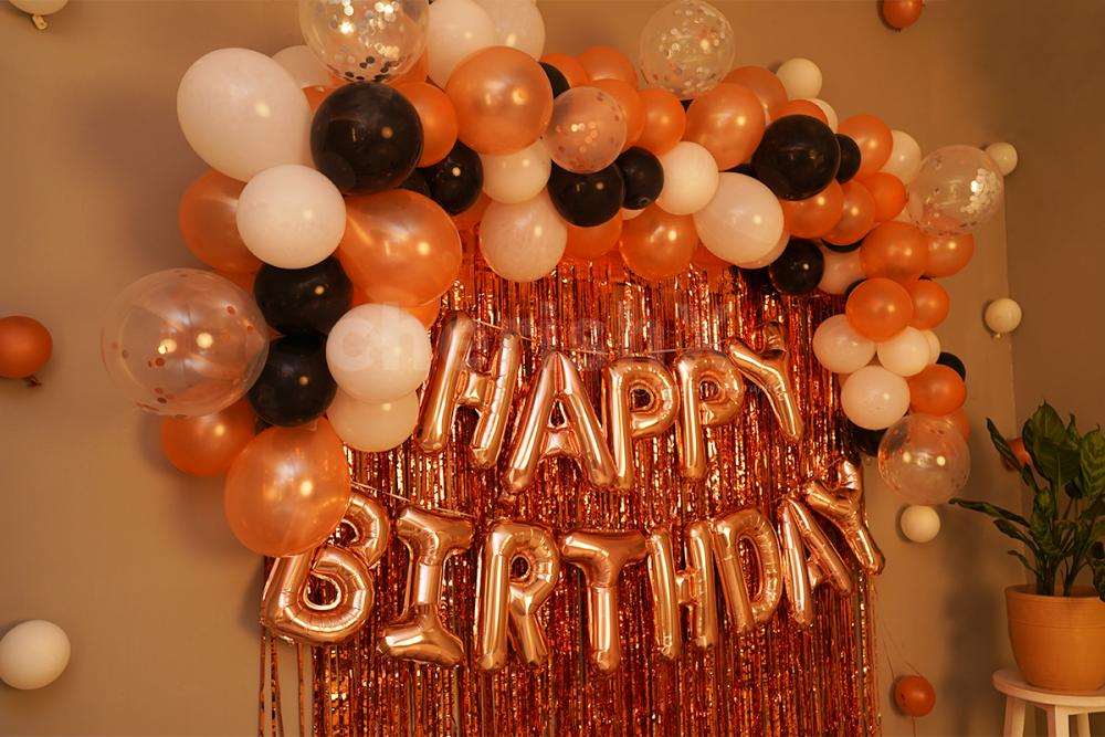 Rosegold Frill Curtains and Black, White Balloons add an elegant look to the decor.