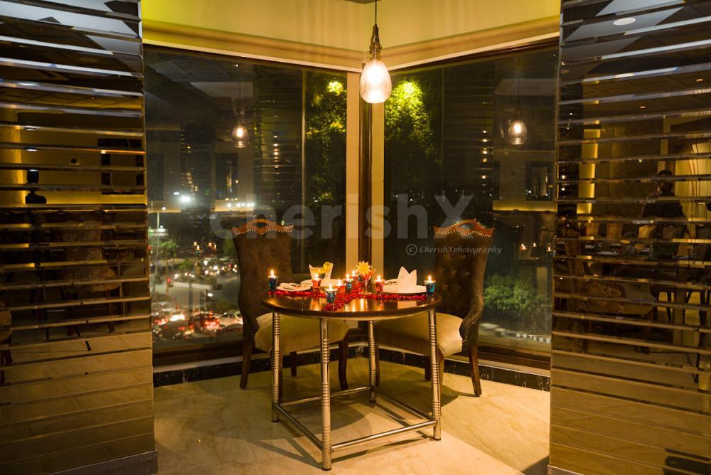 Romantic indoor candlelight dinner in Dwarka